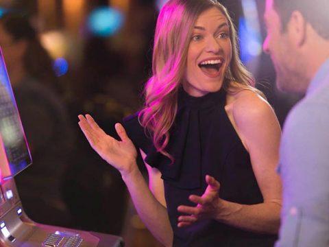Woman celebrating win at The Mill Casino Slots