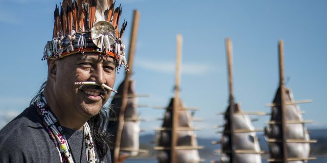 Coquille man wearing headdress at the Salmon Celebration